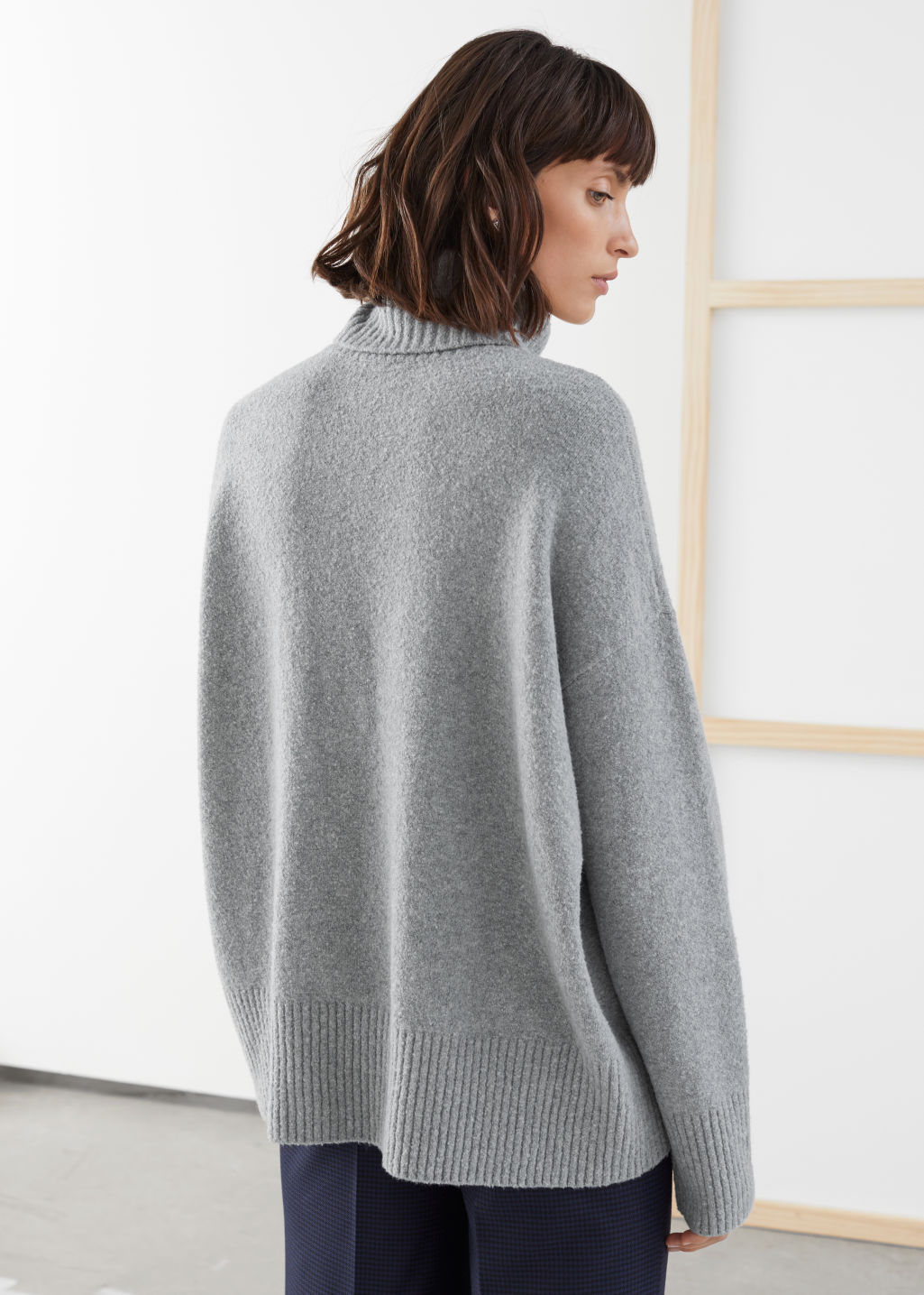 Model back image of Stories high neck sweater in grey