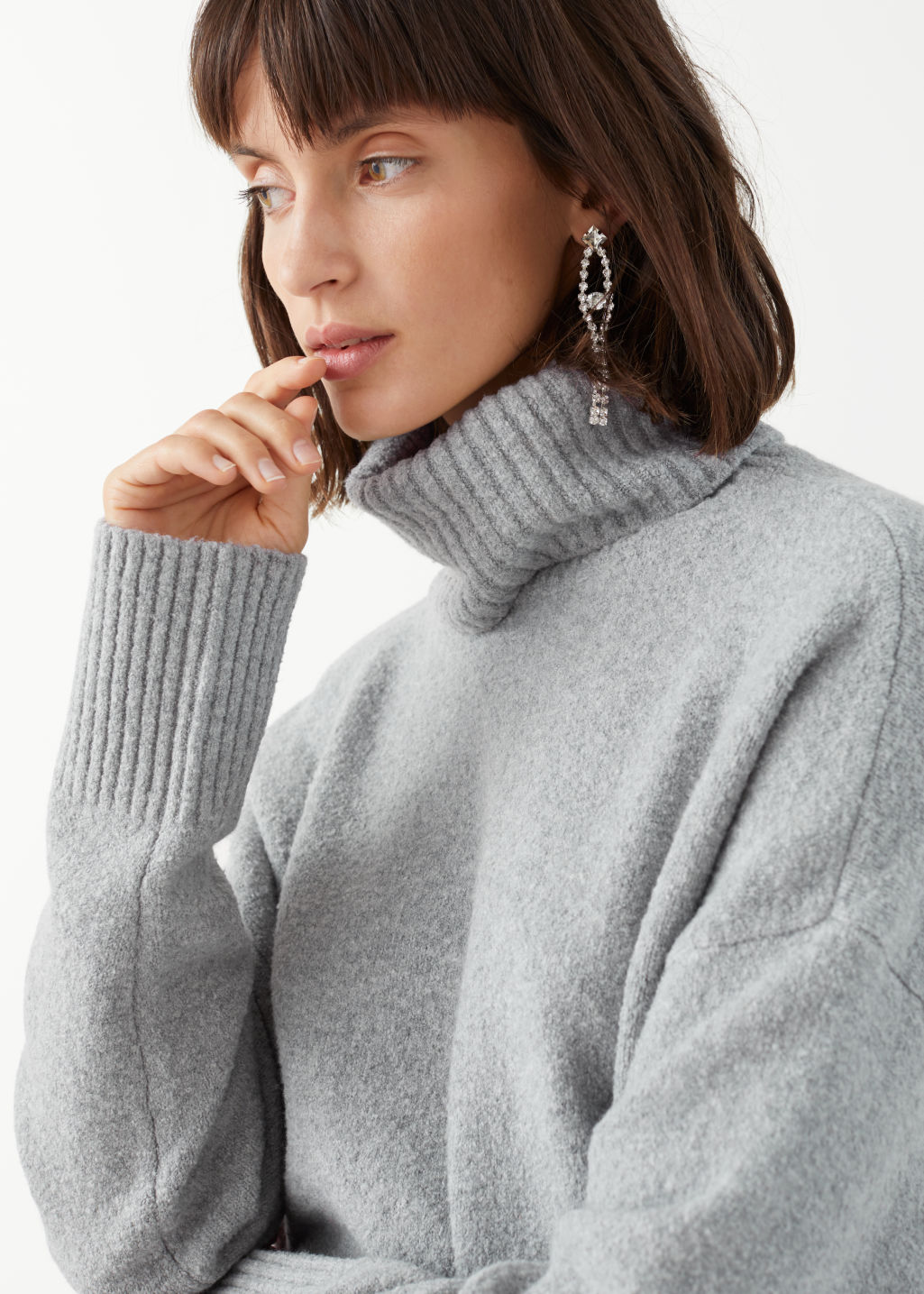 Model side image of Stories high neck sweater in grey