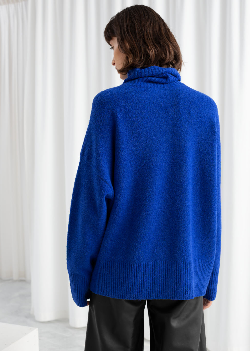 Model back image of Stories high neck sweater in blue