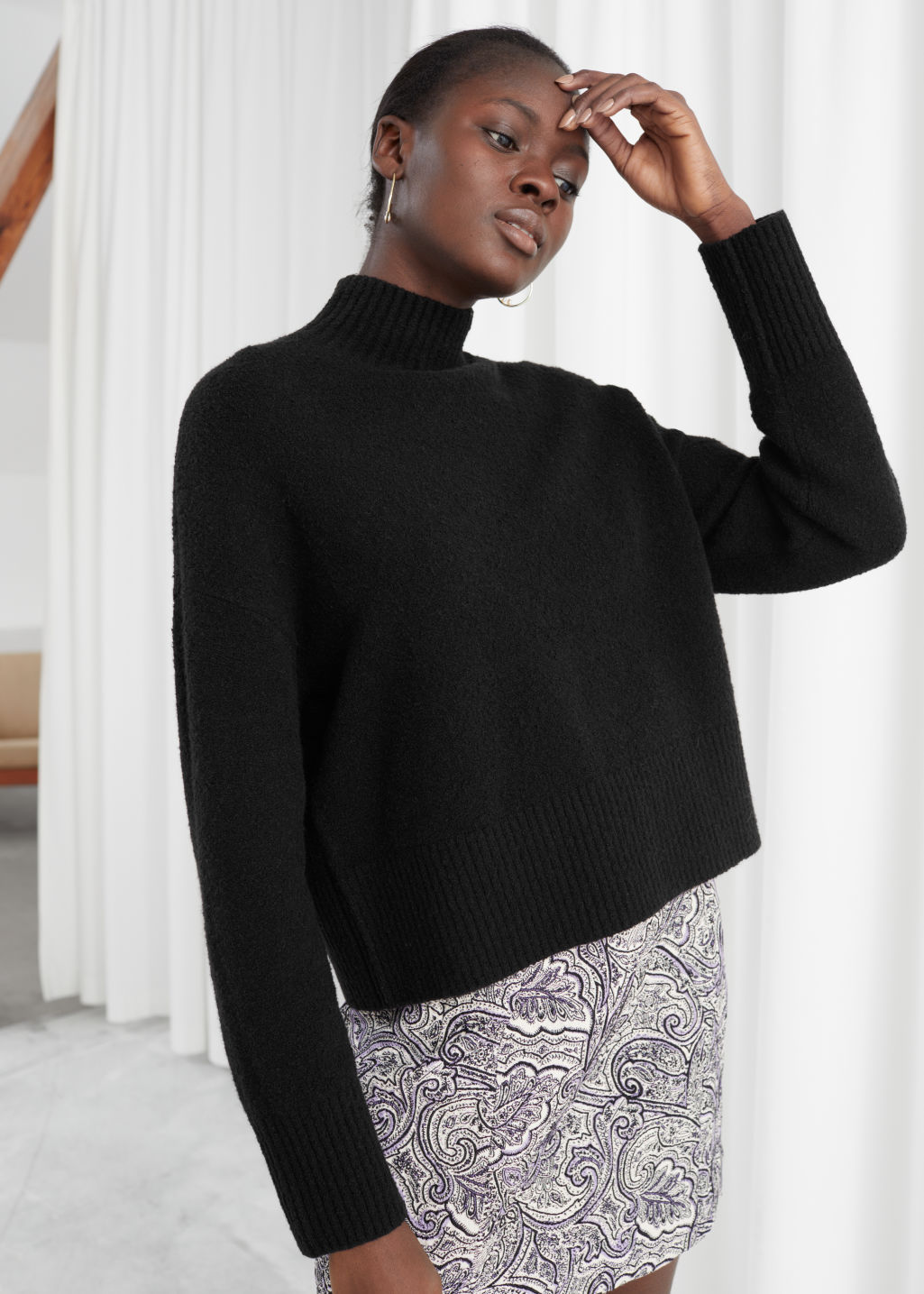 Model front image of Stories cropped mock neck sweater in black