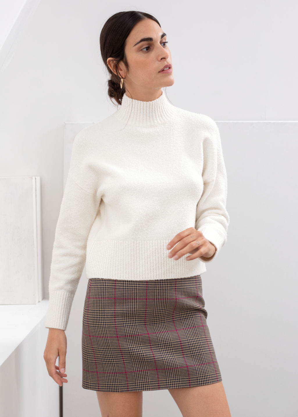 Model front image of Stories cropped mock neck sweater in white