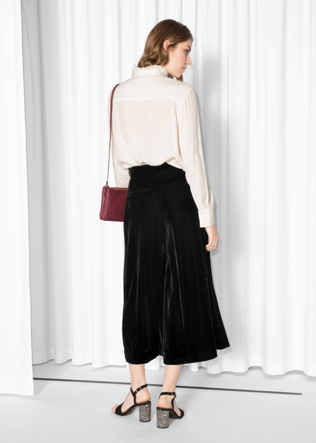 Model back image of Stories velvet culottes in black