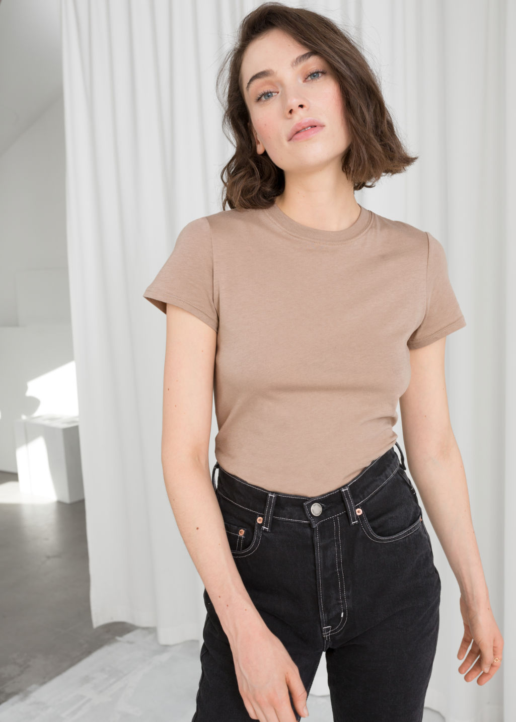 Model front image of Stories cotton jersey t-shirt in beige