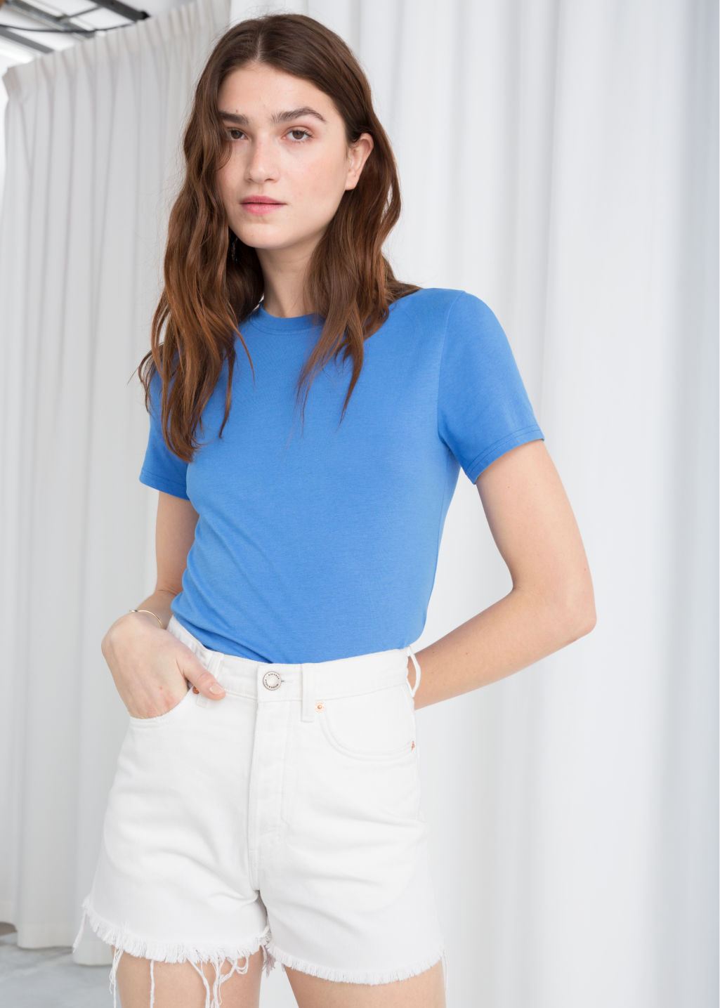 Model front image of Stories cotton jersey t-shirt in blue