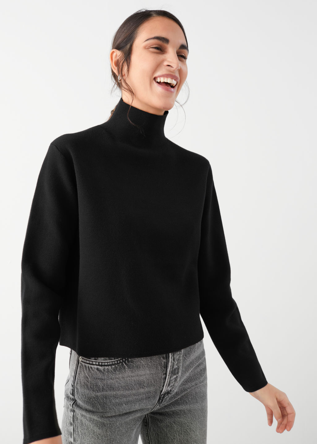 Model front image of Stories tight turtleneck  in black