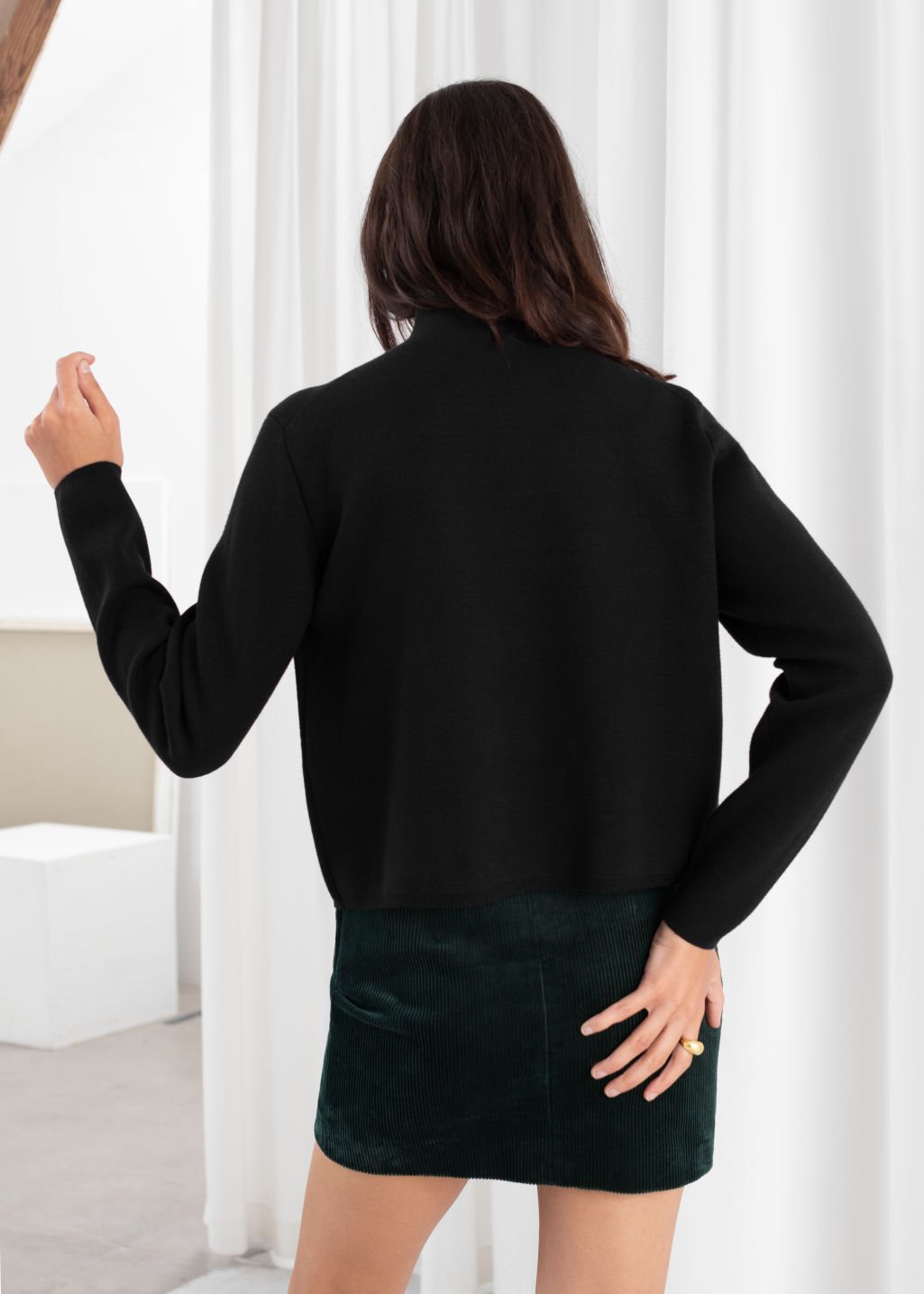 Model back image of Stories fitted turtleneck  in black