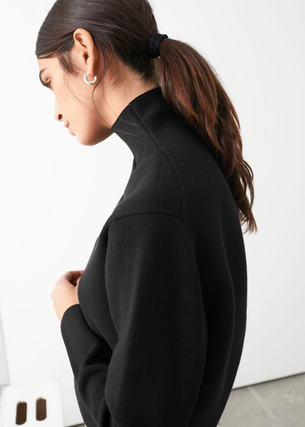 Model side image of Stories cropped relaxed fit turtleneck in black