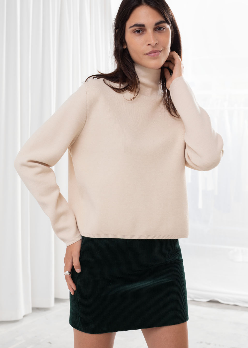 Model front image of Stories fitted turtleneck  in beige