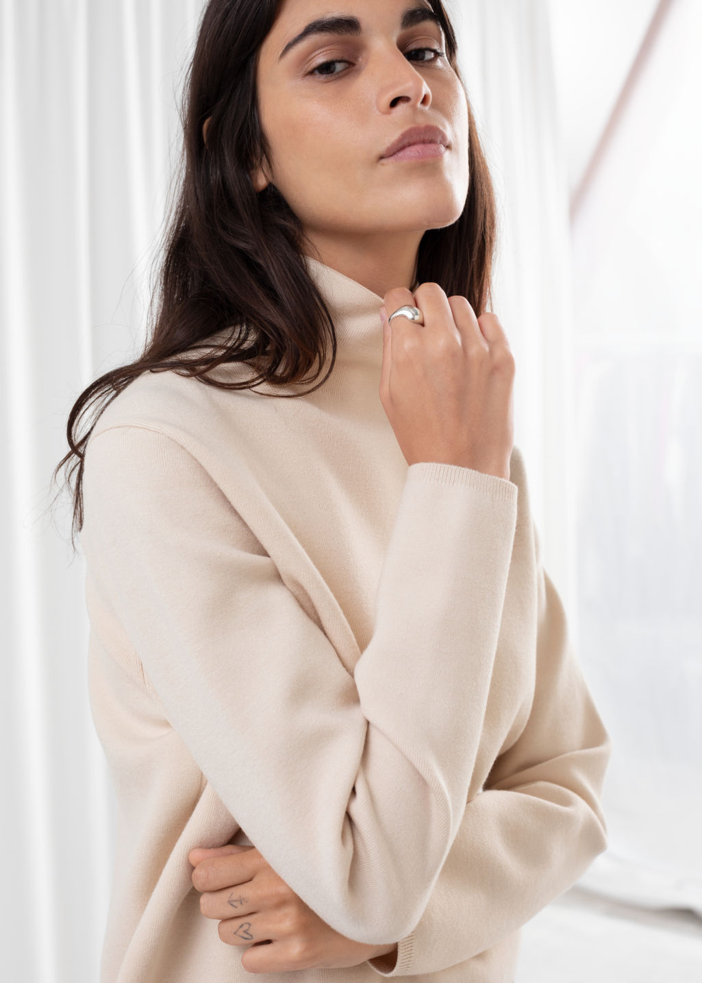 Model front image of Stories cropped relaxed fit turtleneck  in beige