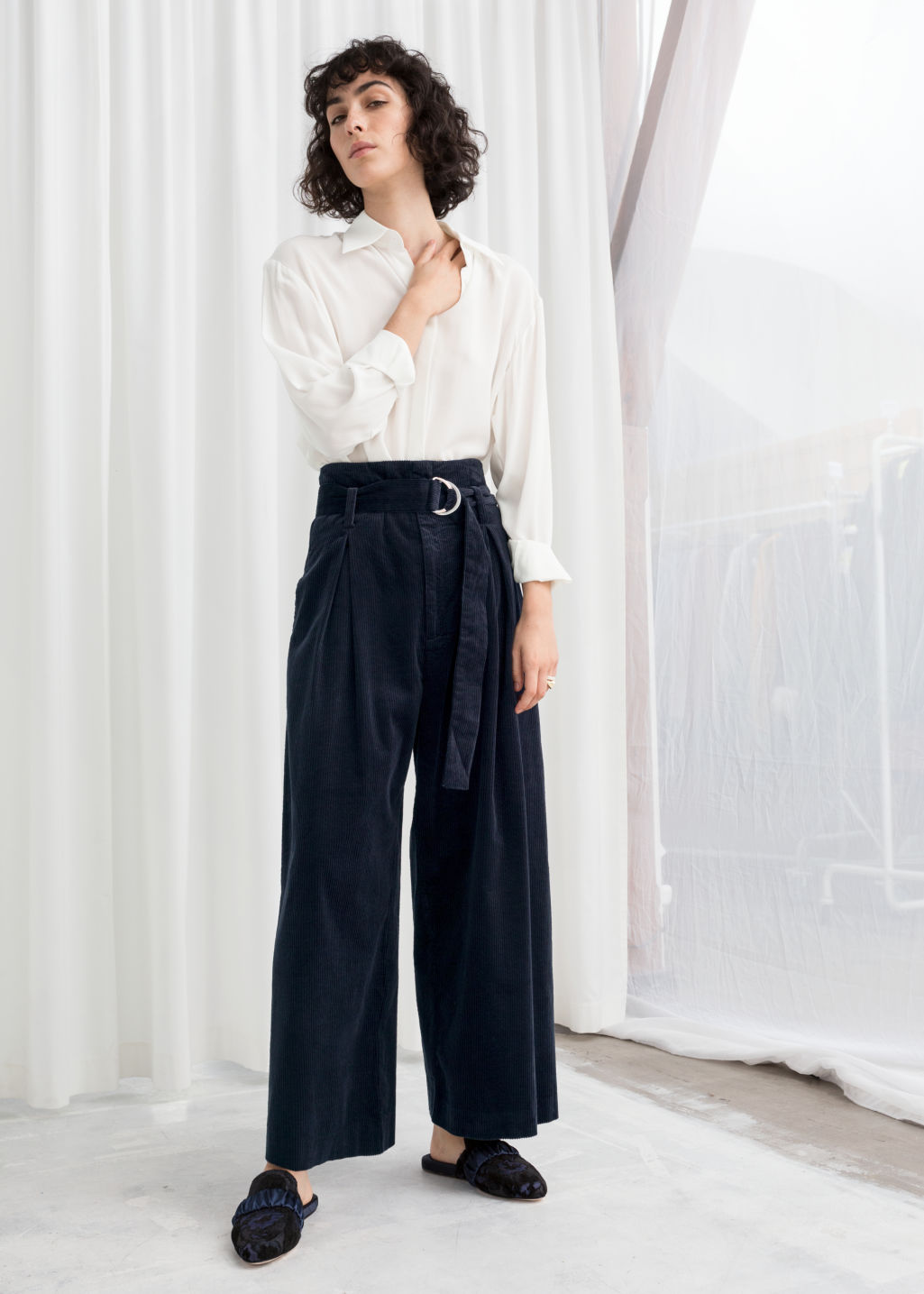 Model front image of Stories wide corduroy trousers in blue