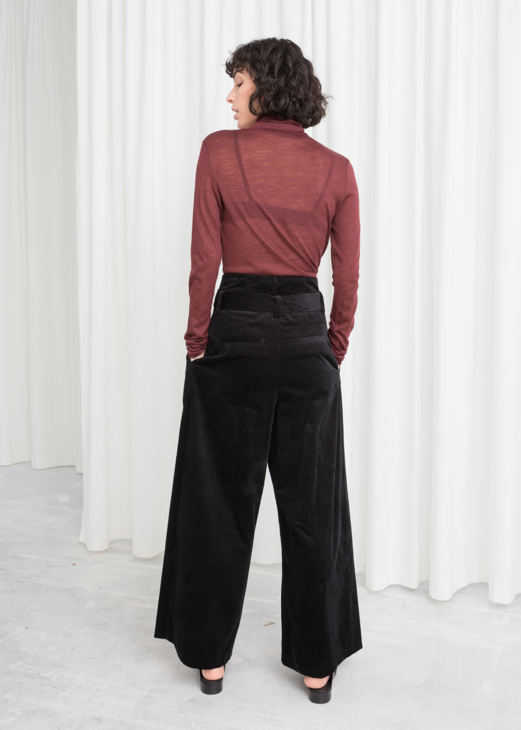 Model back image of Stories wide corduroy trousers in black