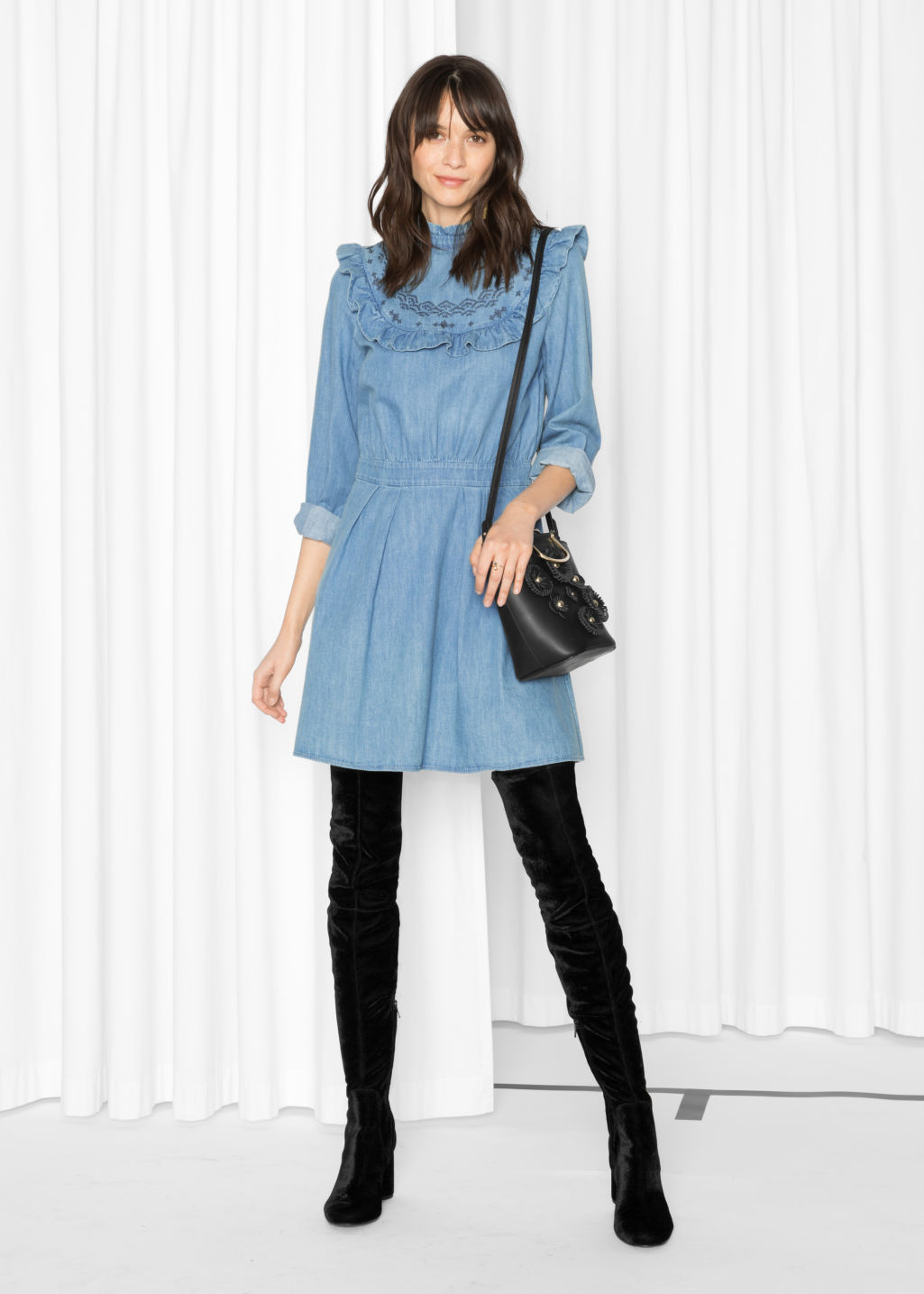 Model front image of Stories frill denim dress in blue