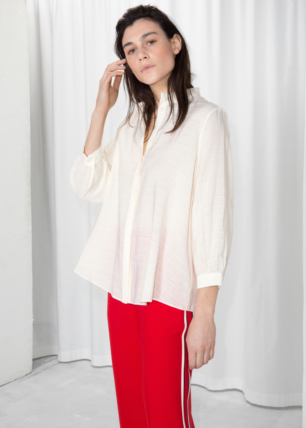 Model front image of Stories relaxed ruffle collar blouse in white
