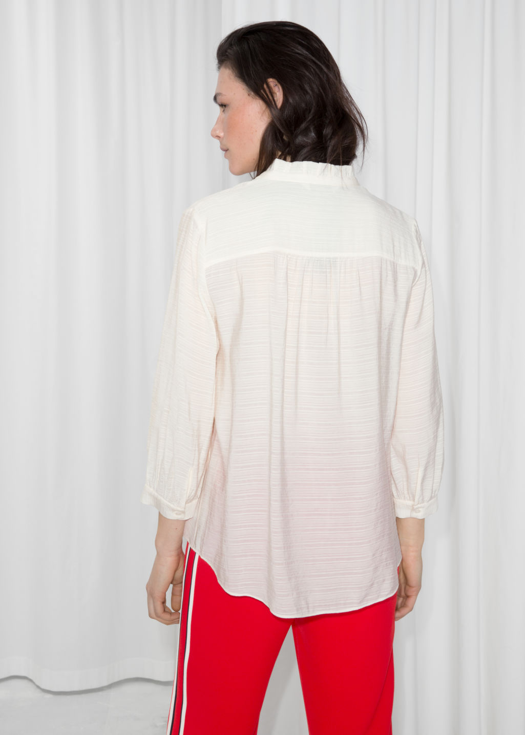 Model back image of Stories relaxed ruffle collar blouse in white