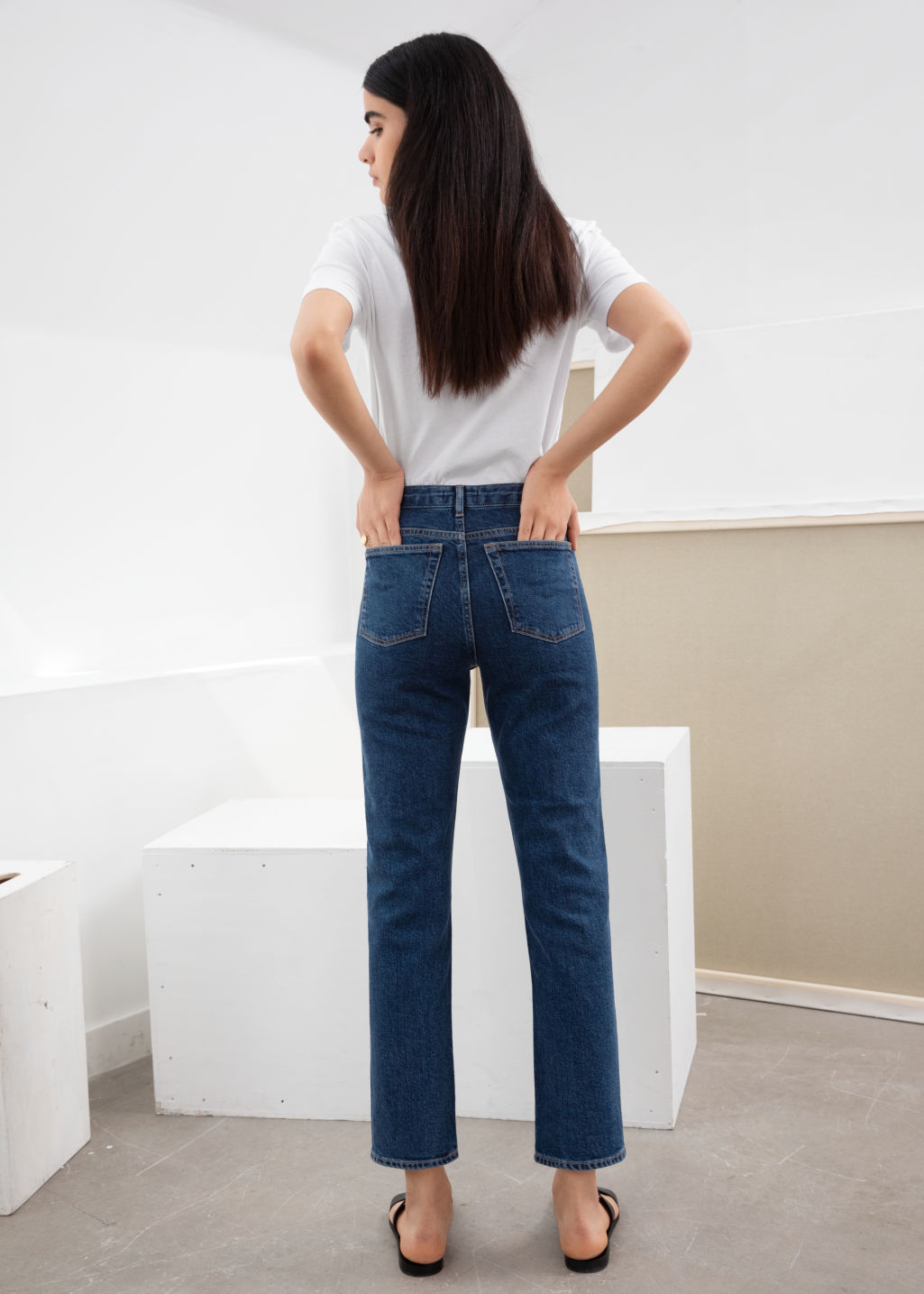 Model back image of Stories straight denim jeans in blue