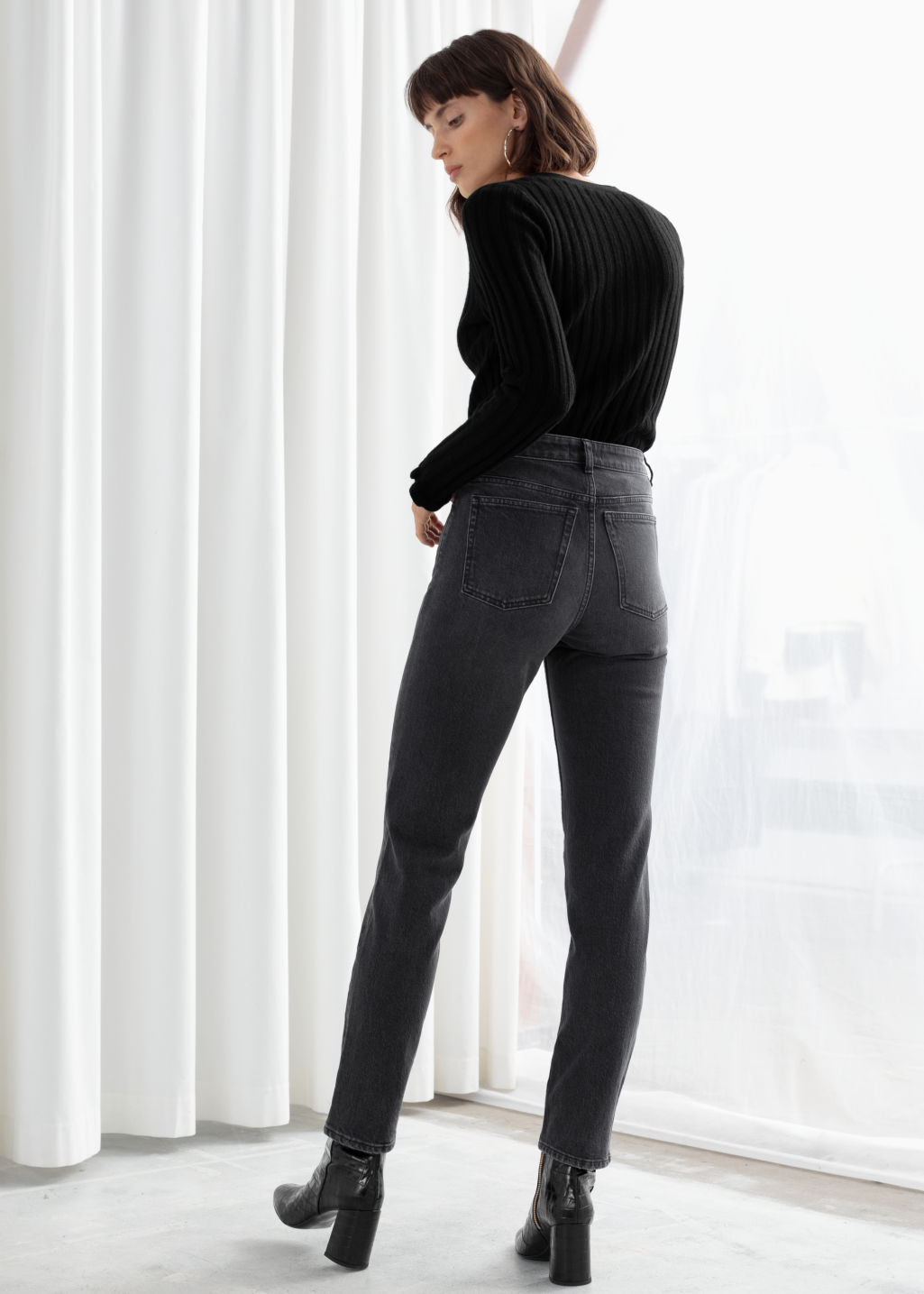 Model back image of Stories straight stretch jeans in grey