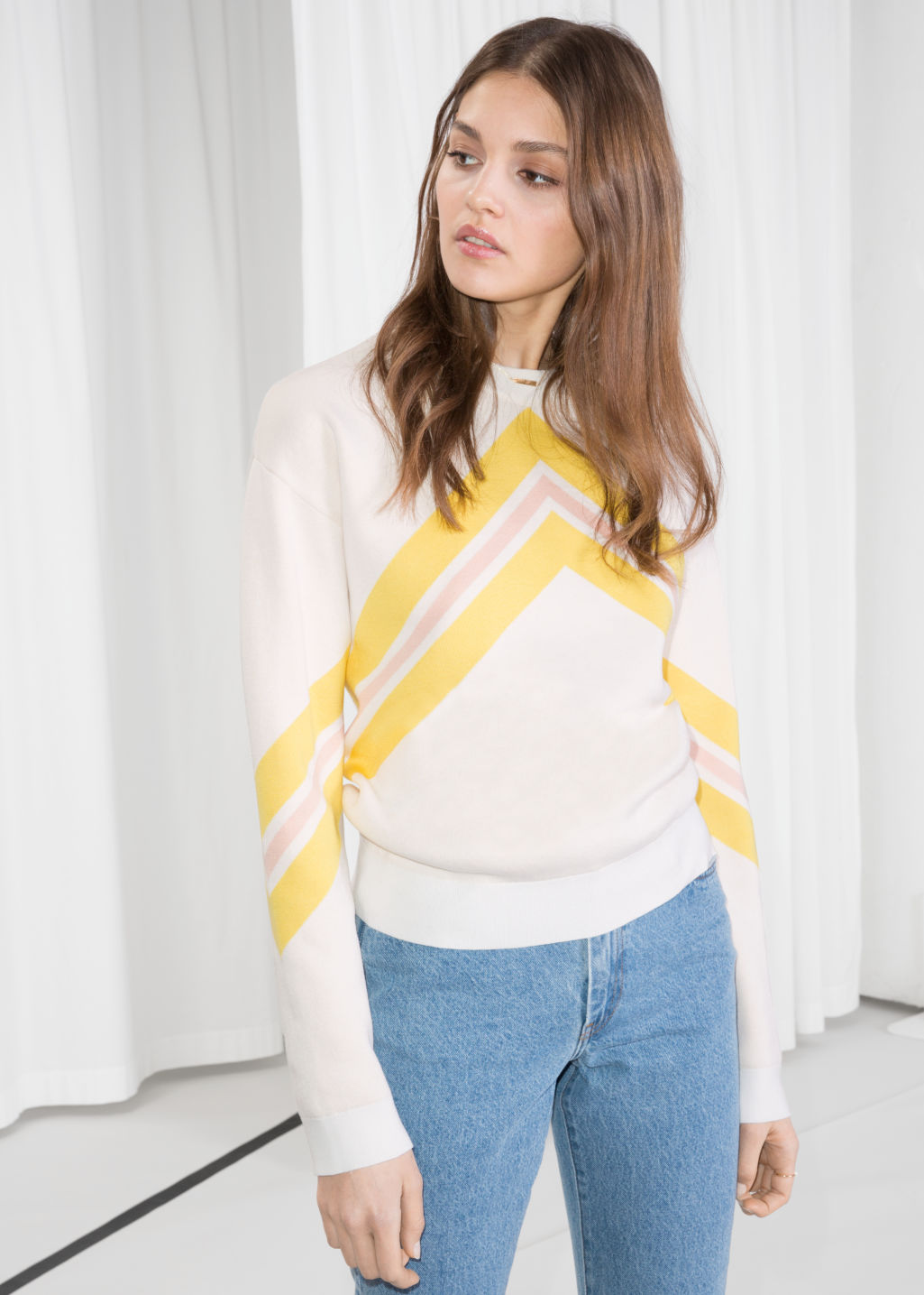 Model front image of Stories varsity knit sweater in white