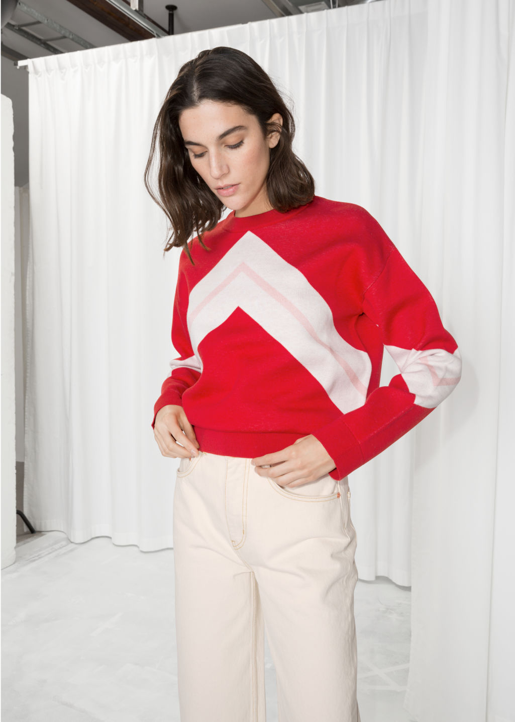 Model front image of Stories varsity knit sweater in red