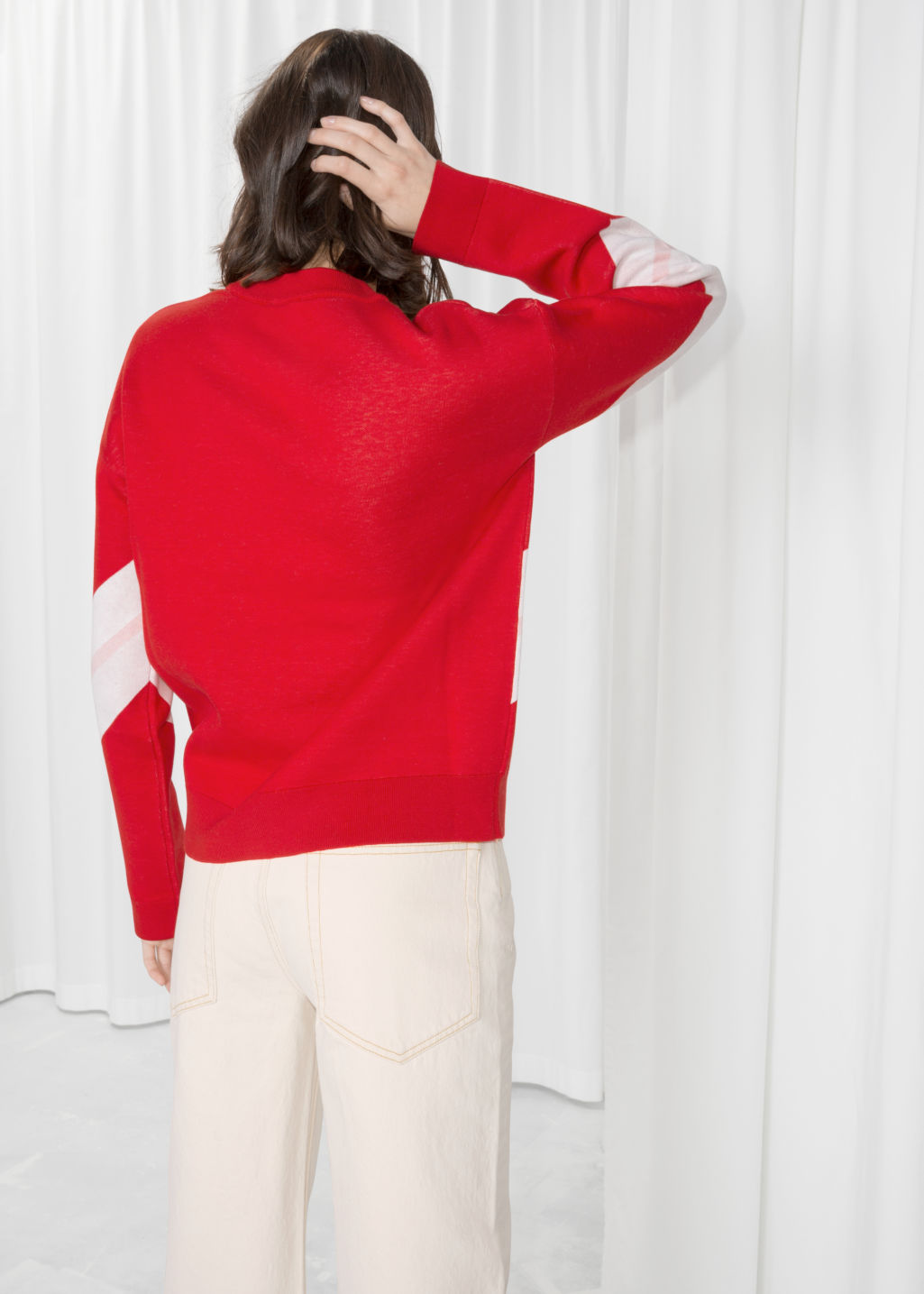 Model back image of Stories varsity knit sweater in red