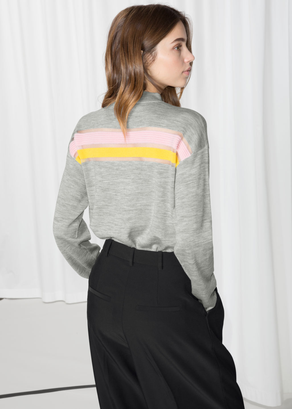 Model back image of Stories colour block wool sweater in grey