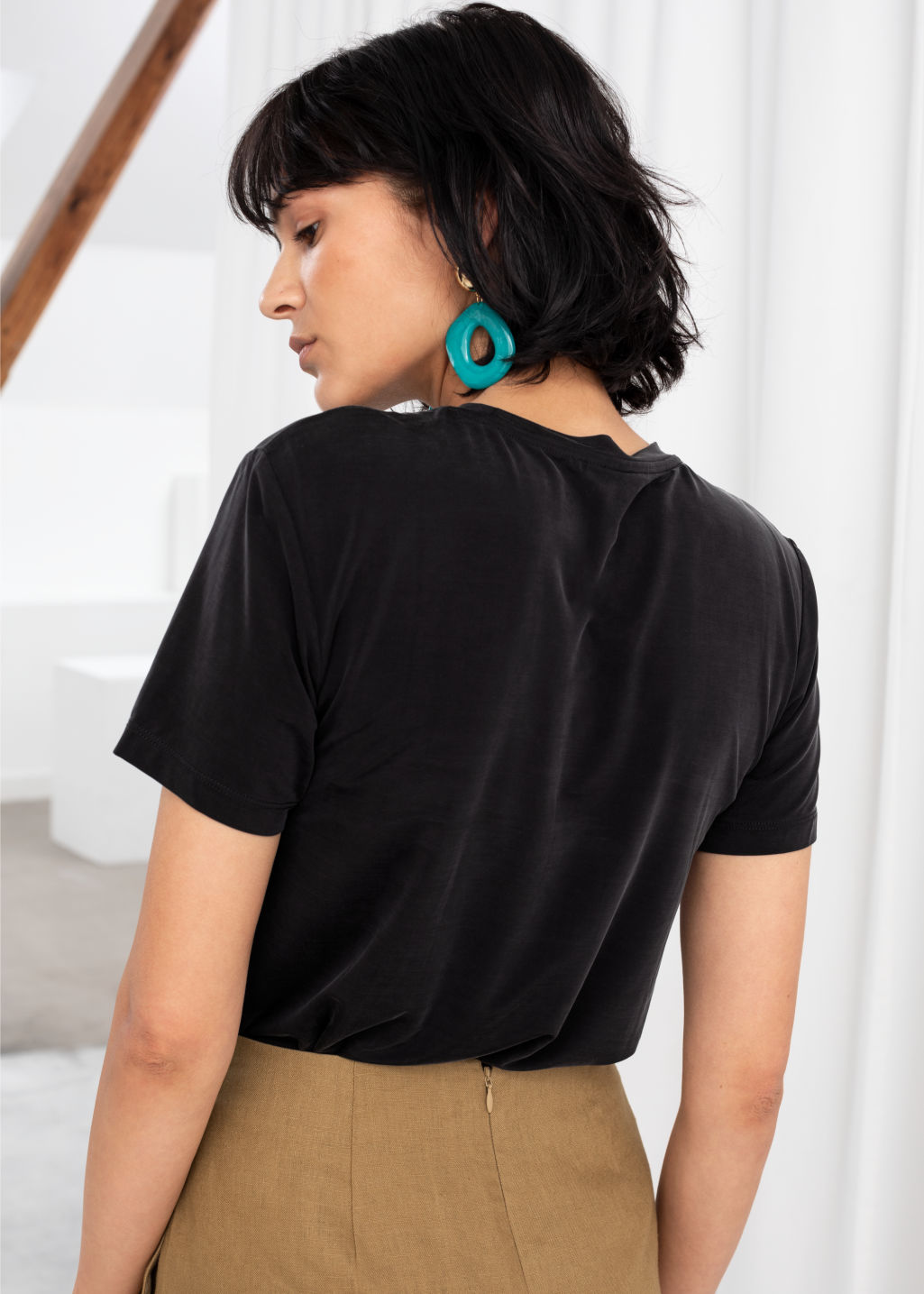 Model back image of Stories cupro t-shirt in black