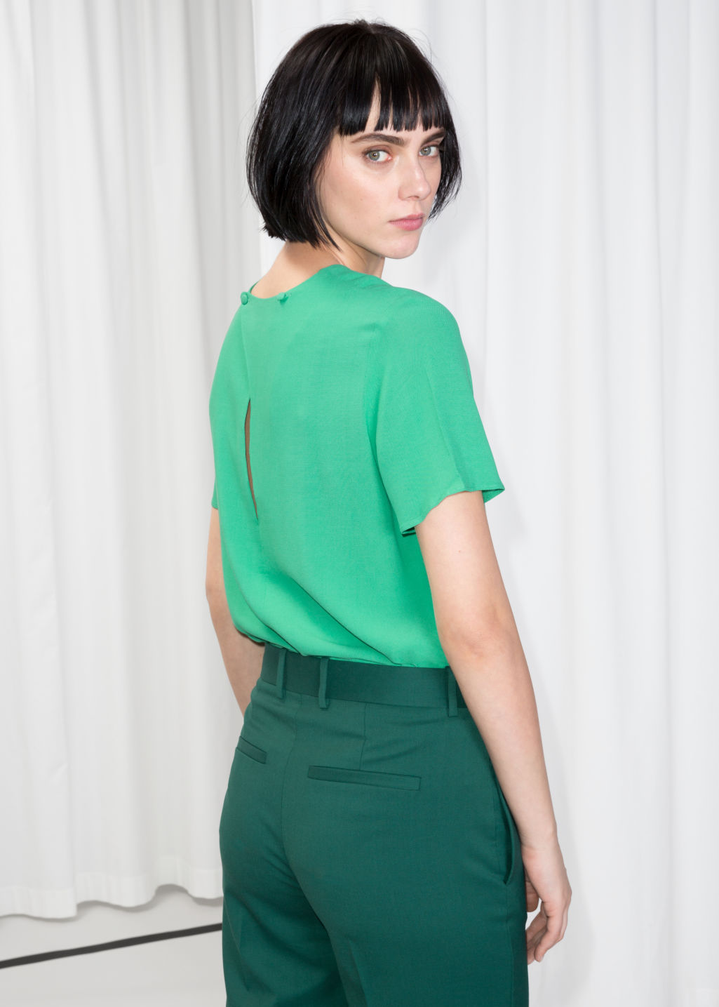 Model front image of Stories loose top  in green