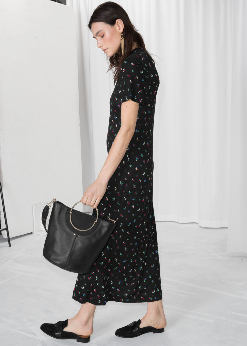 Model front image of Stories petals maxi dress in black