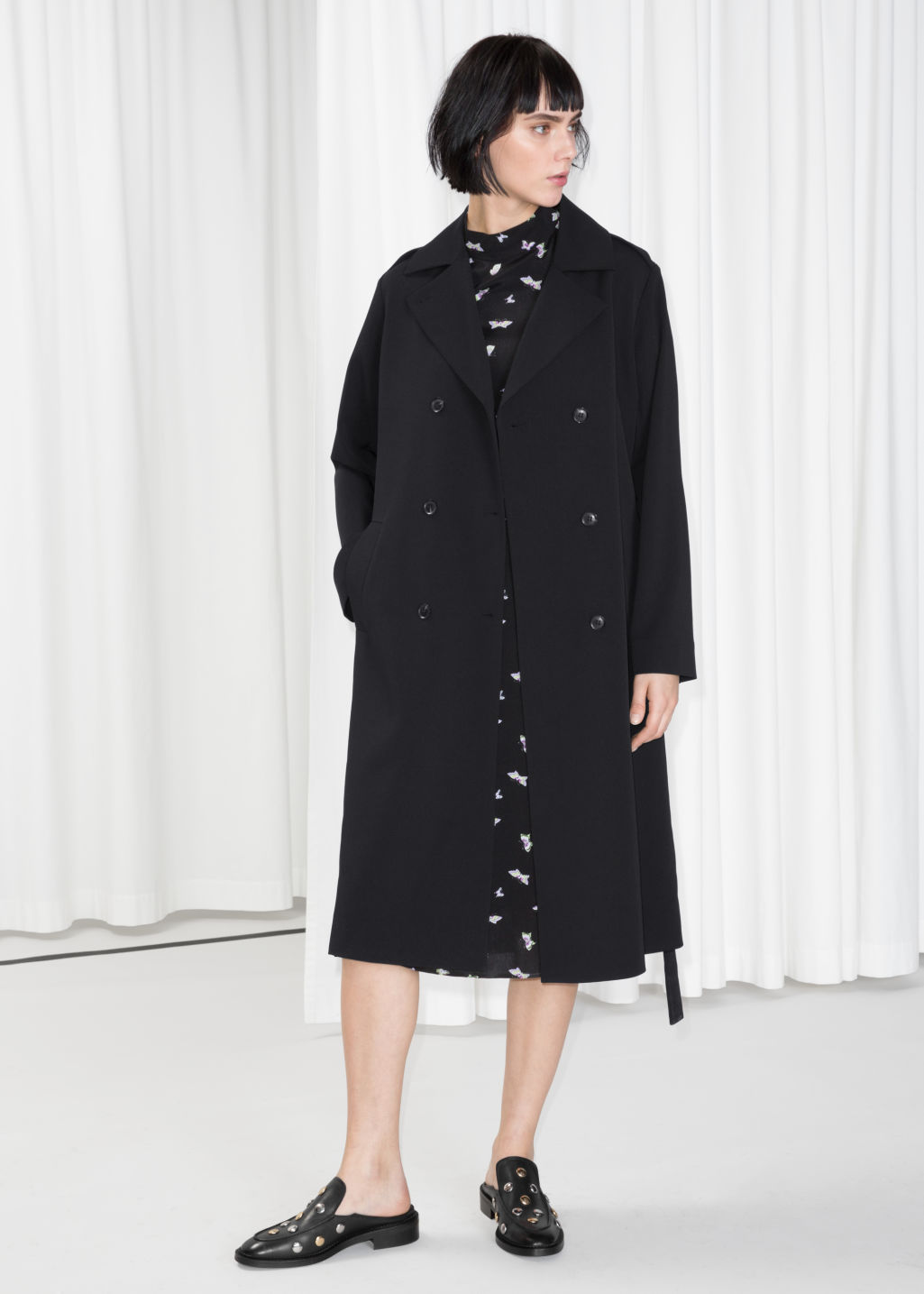 Model front image of Stories double breasted trench coat in black