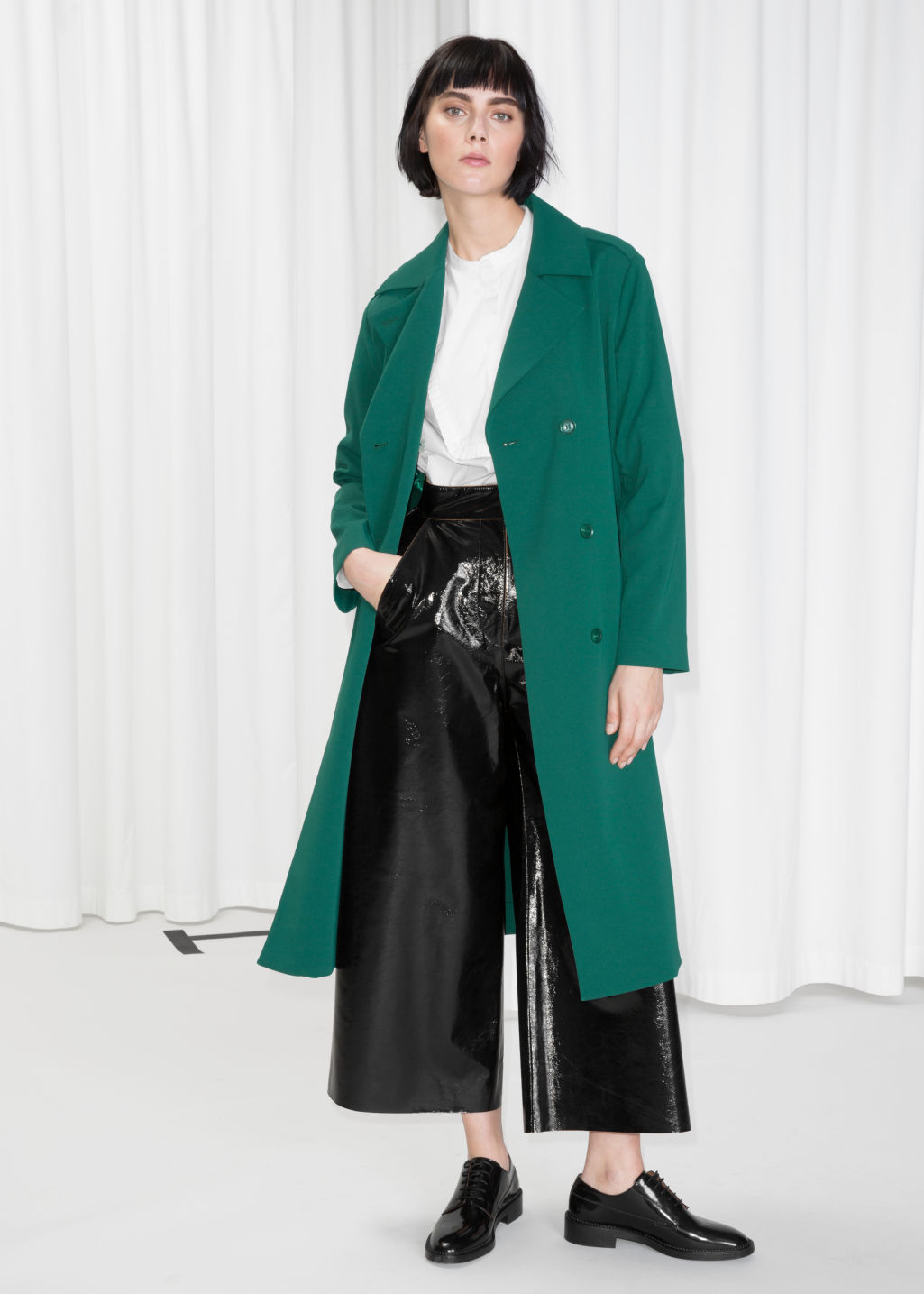 Model front image of Stories double breasted trench coat in green