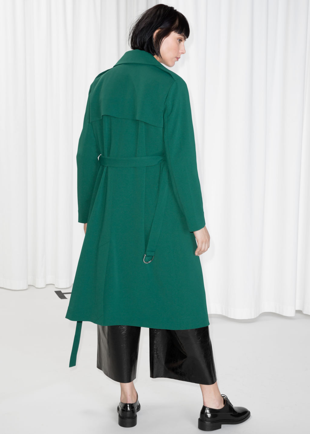 Model back image of Stories double breasted trench coat in green