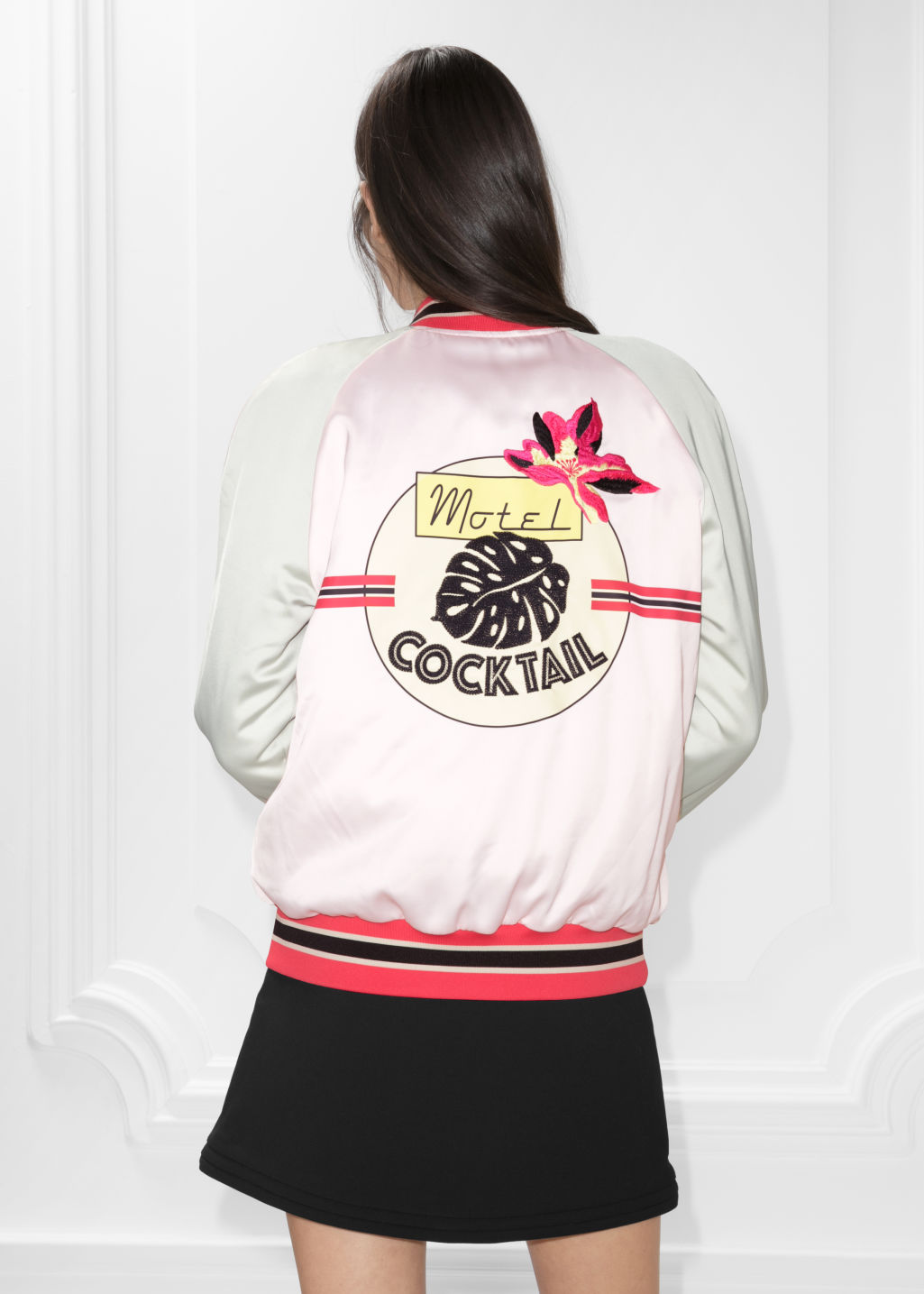 Model front image of Stories patch bomber jacket in pink