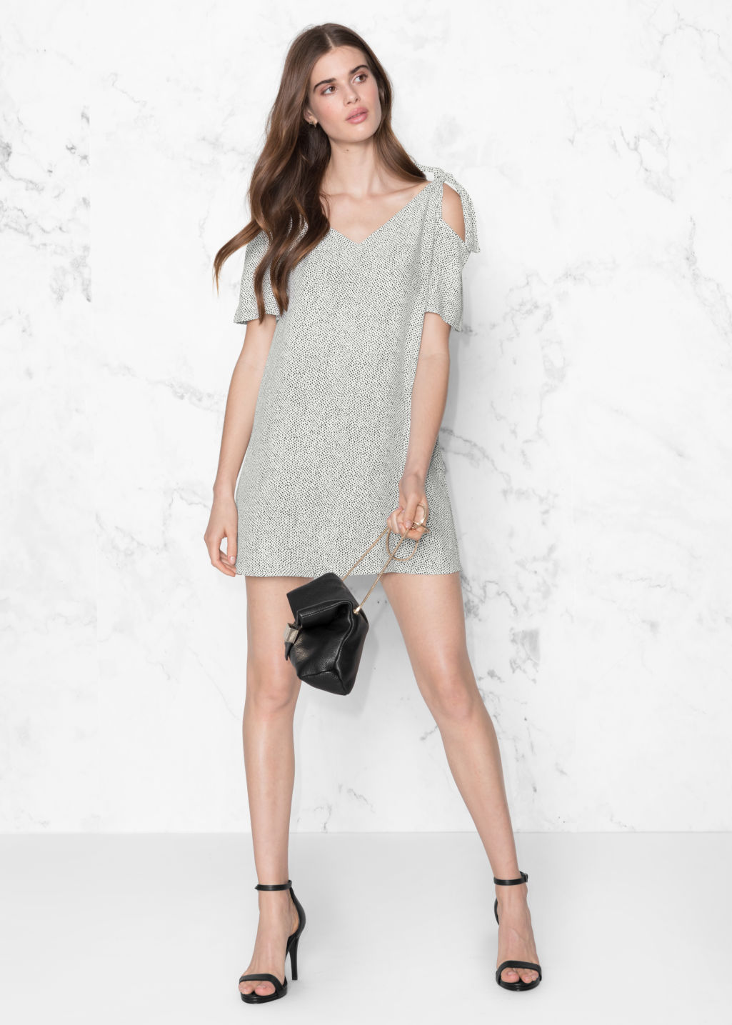 Model front image of Stories cold shoulder knotted dress in white
