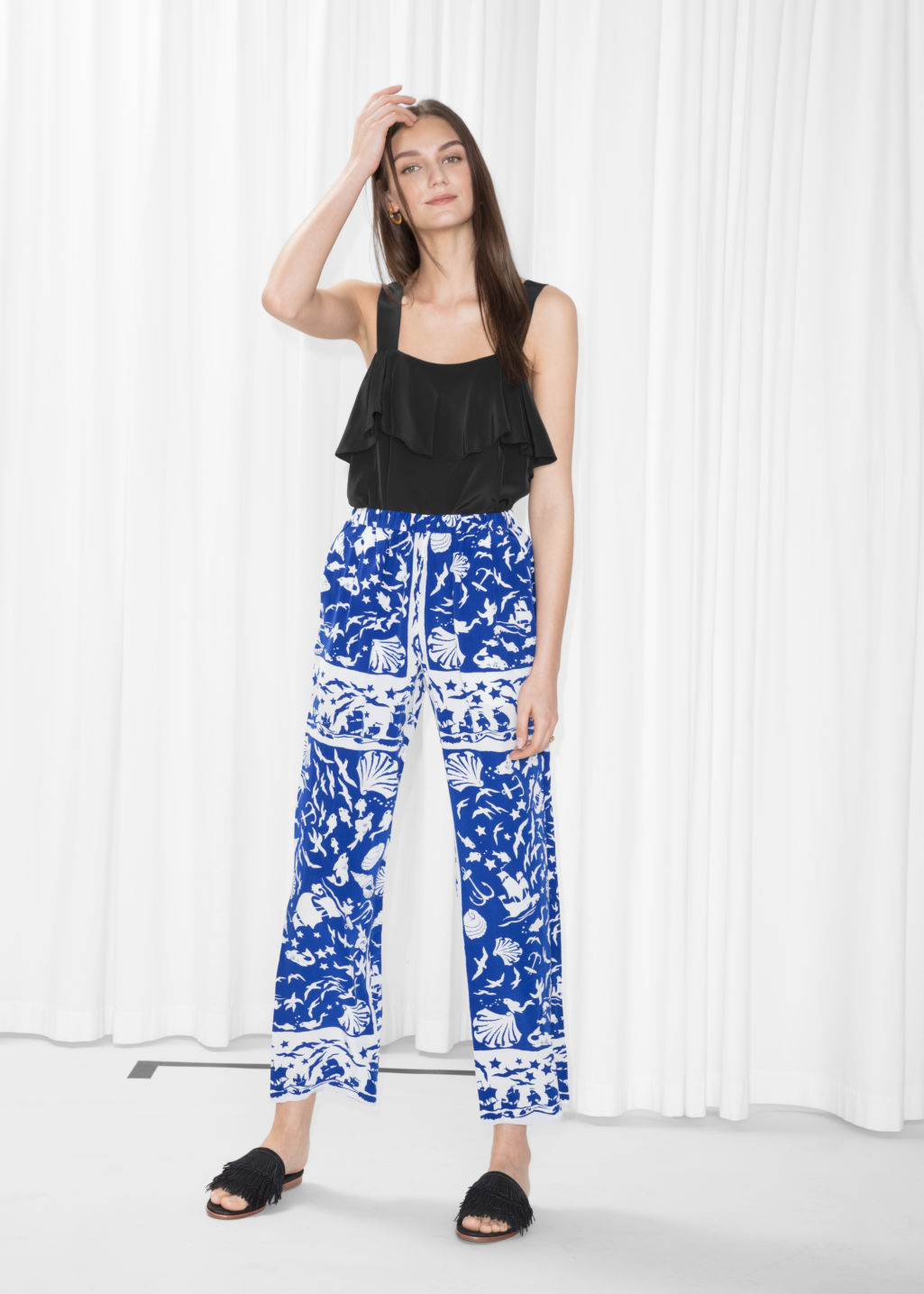Model front image of Stories shoreline pull-on trousers in blue