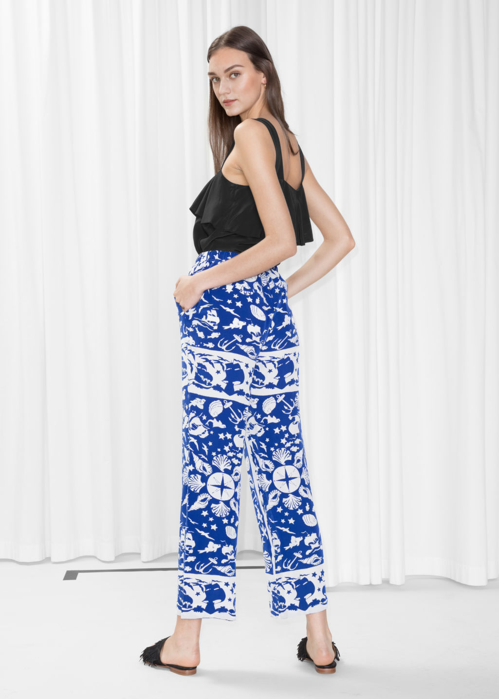 Model back image of Stories shoreline pull-on trousers in blue
