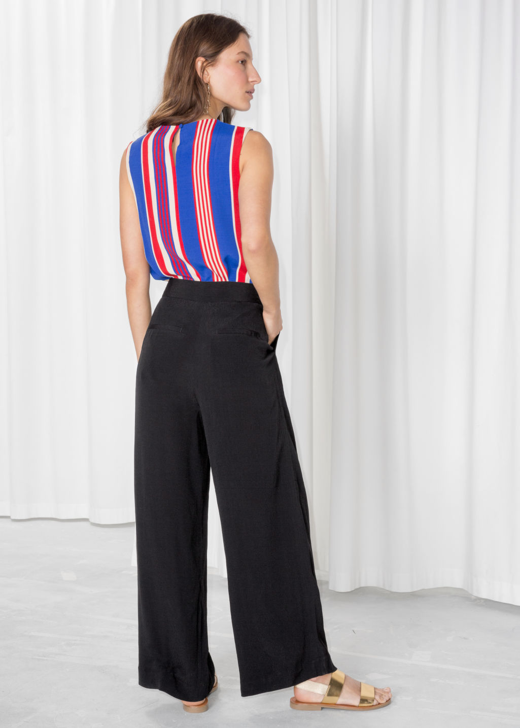 Model back image of Stories wide leg trousers in black