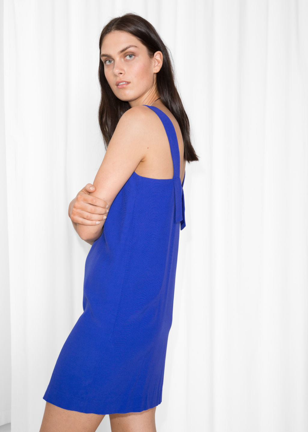 Model back image of Stories wide strap dress in blue