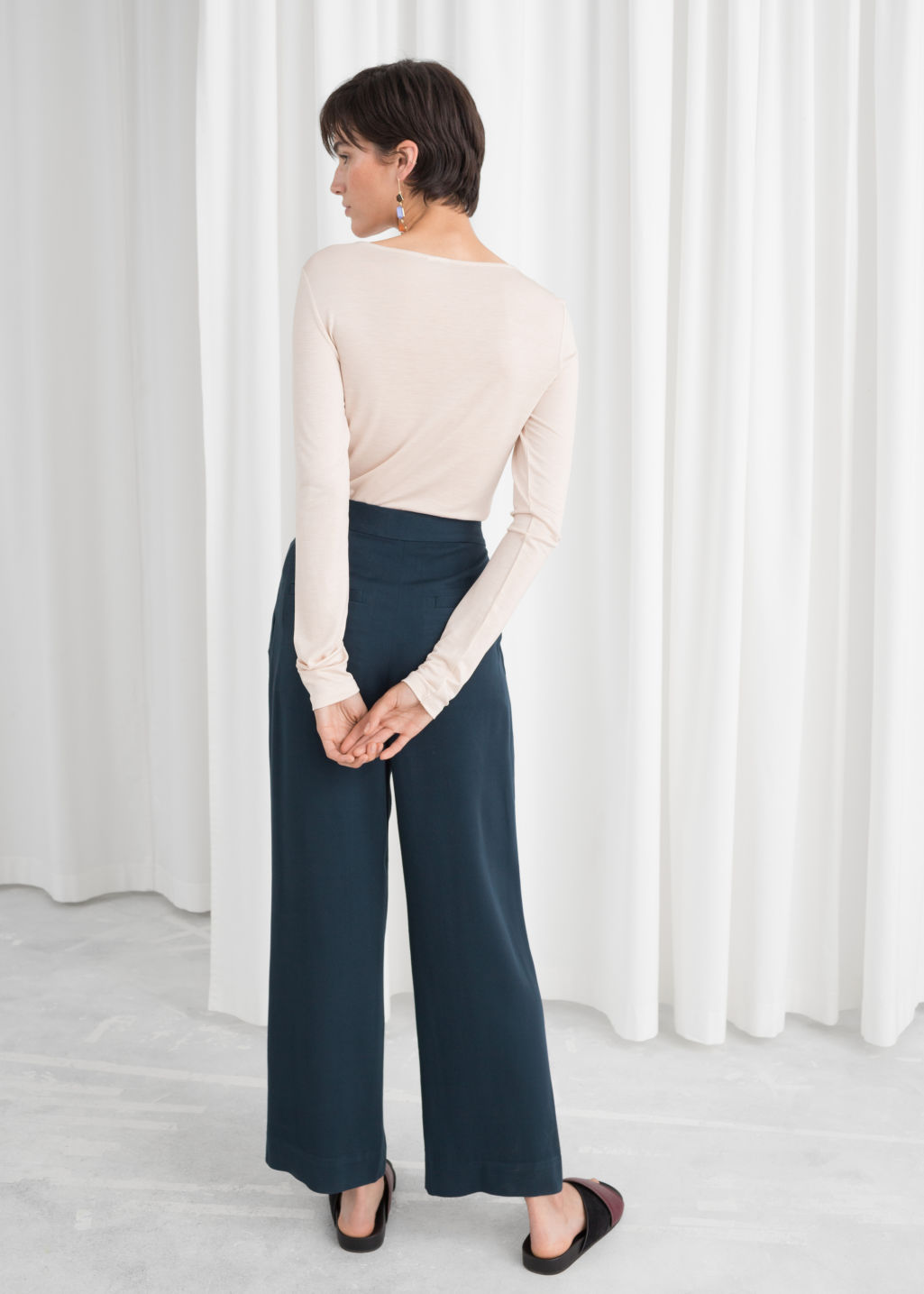 Model back image of Stories tailored trousers in blue