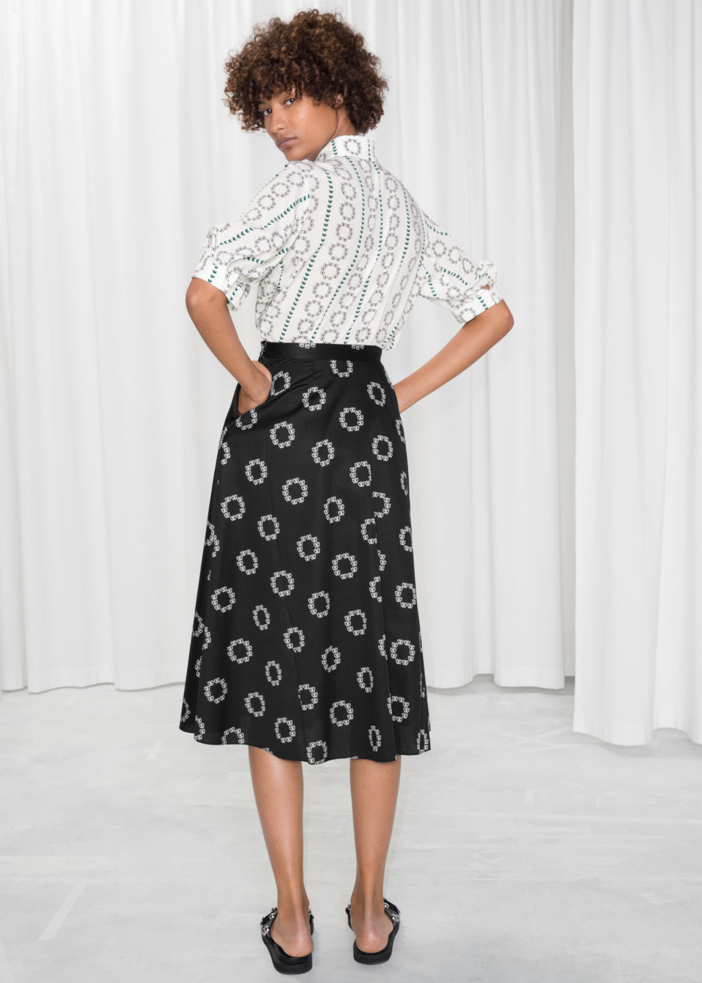 Model back image of Stories painted dots a-line skirt in black