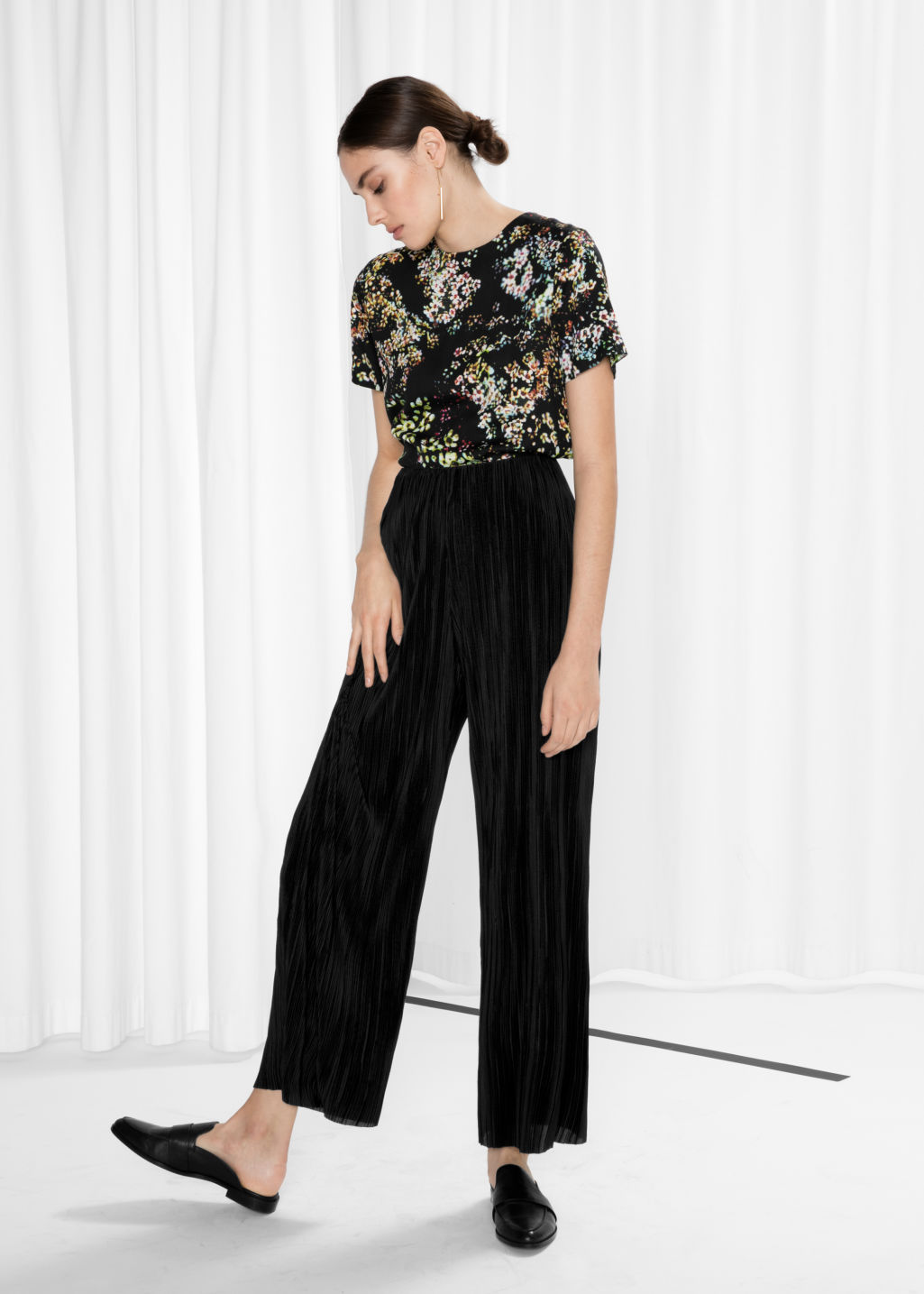 Model front image of Stories pleated trousers in black