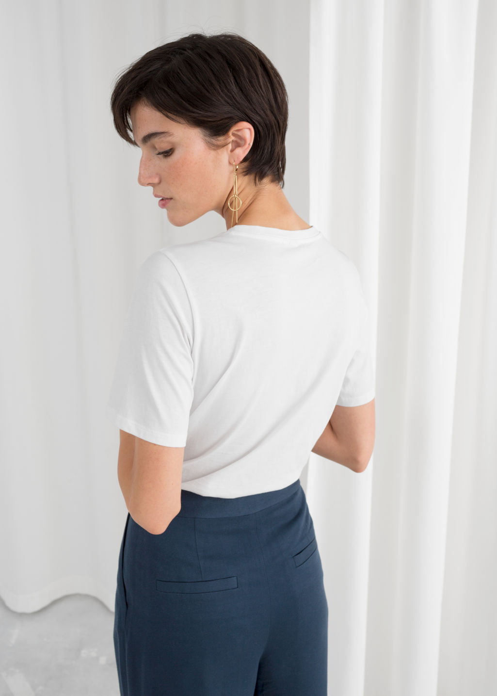 Model back image of Stories organic cotton t-shirt in white