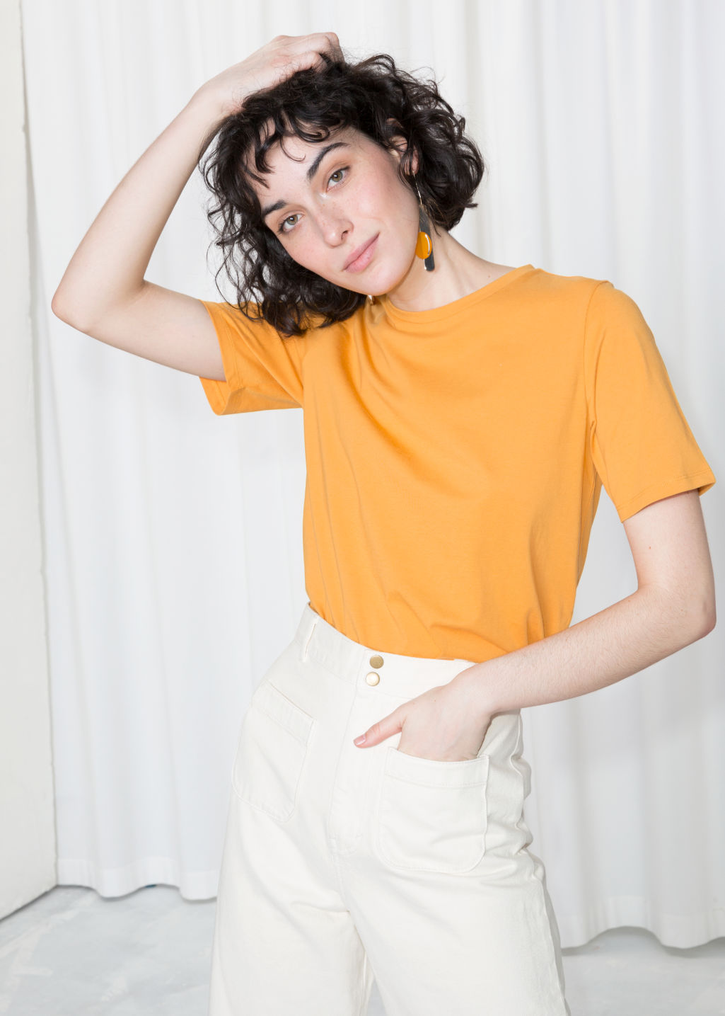 Model front image of Stories crewneck organic cotton tee in yellow