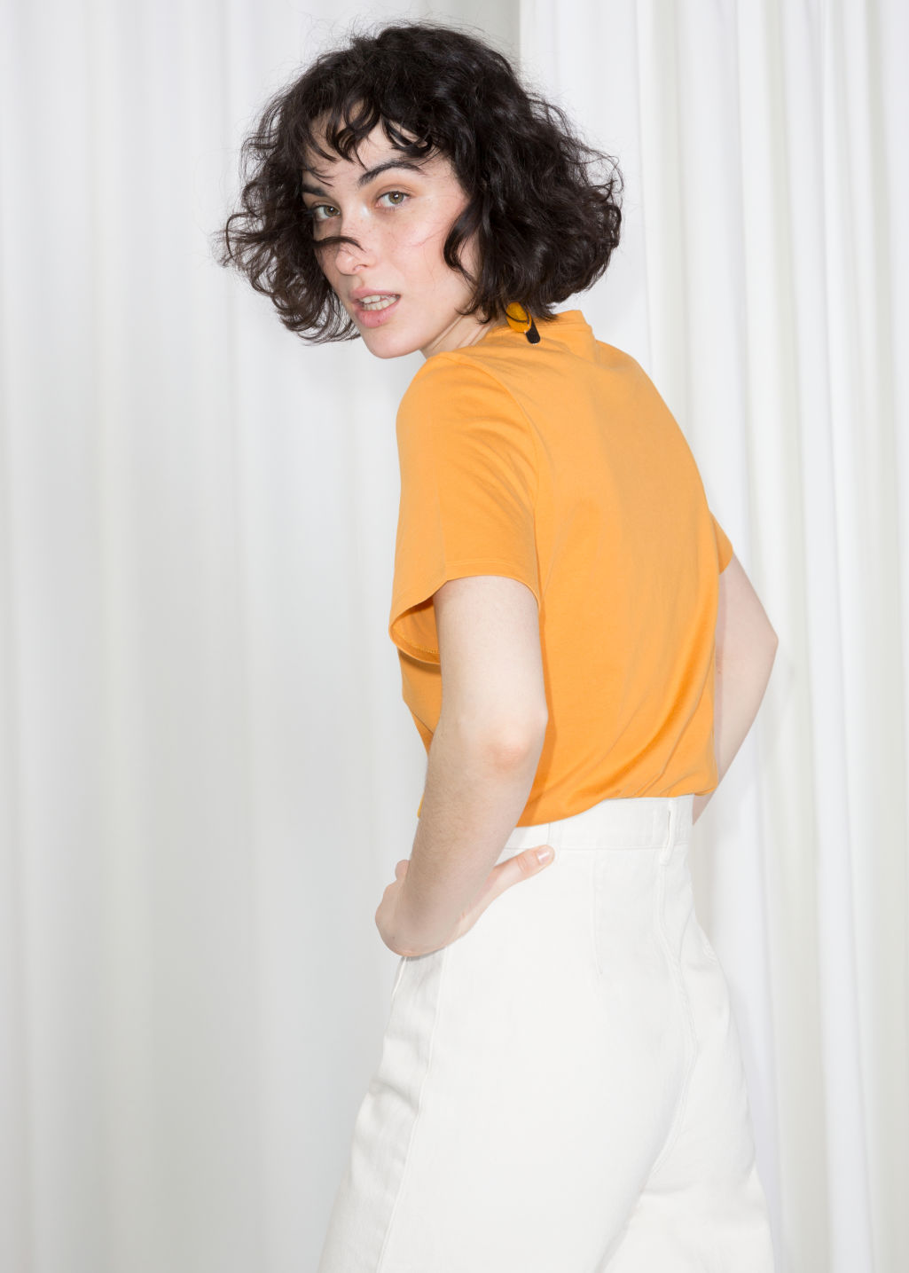 Model back image of Stories crewneck organic cotton tee in yellow
