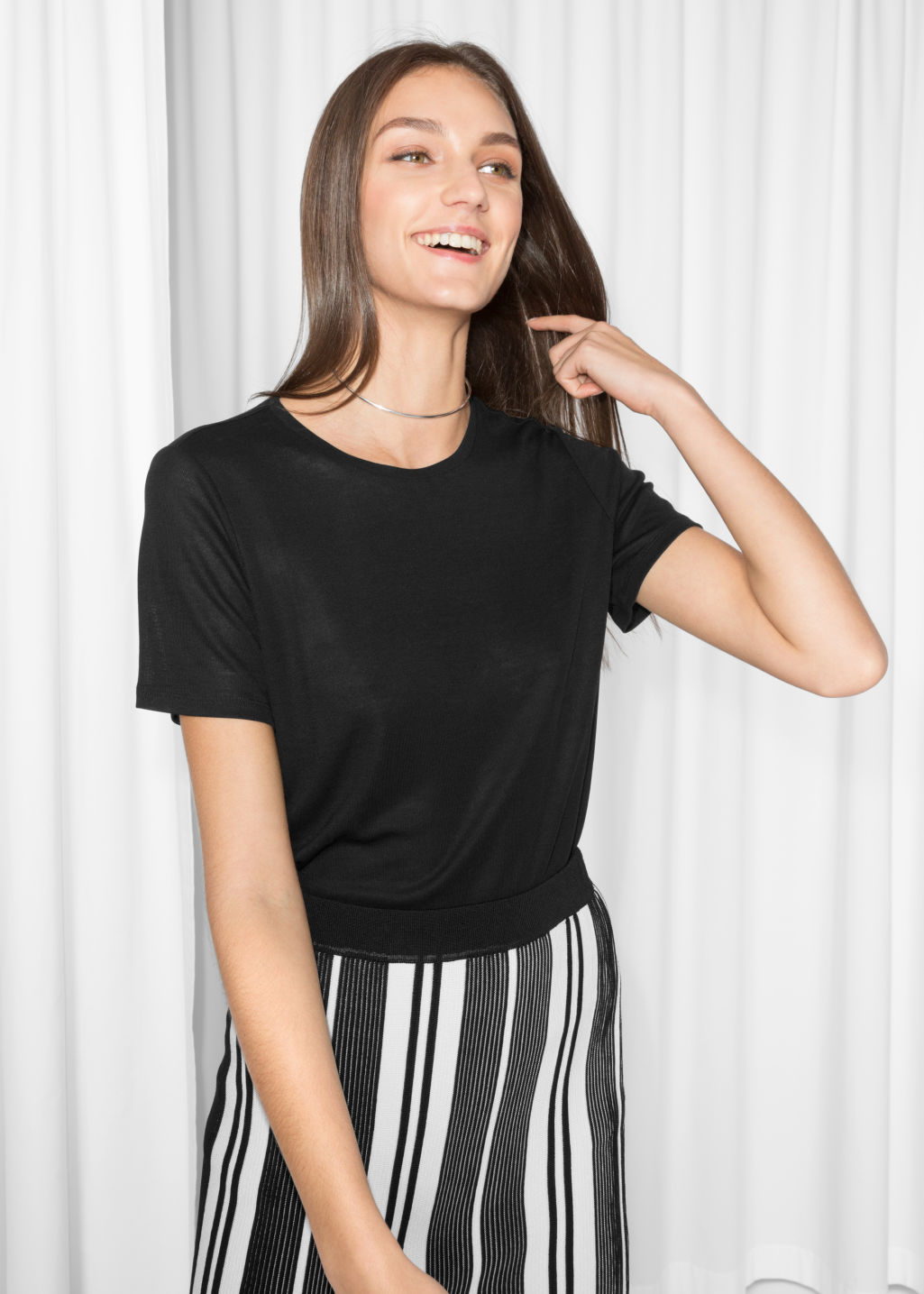 Model front image of Stories rib tencel t-shirt in black