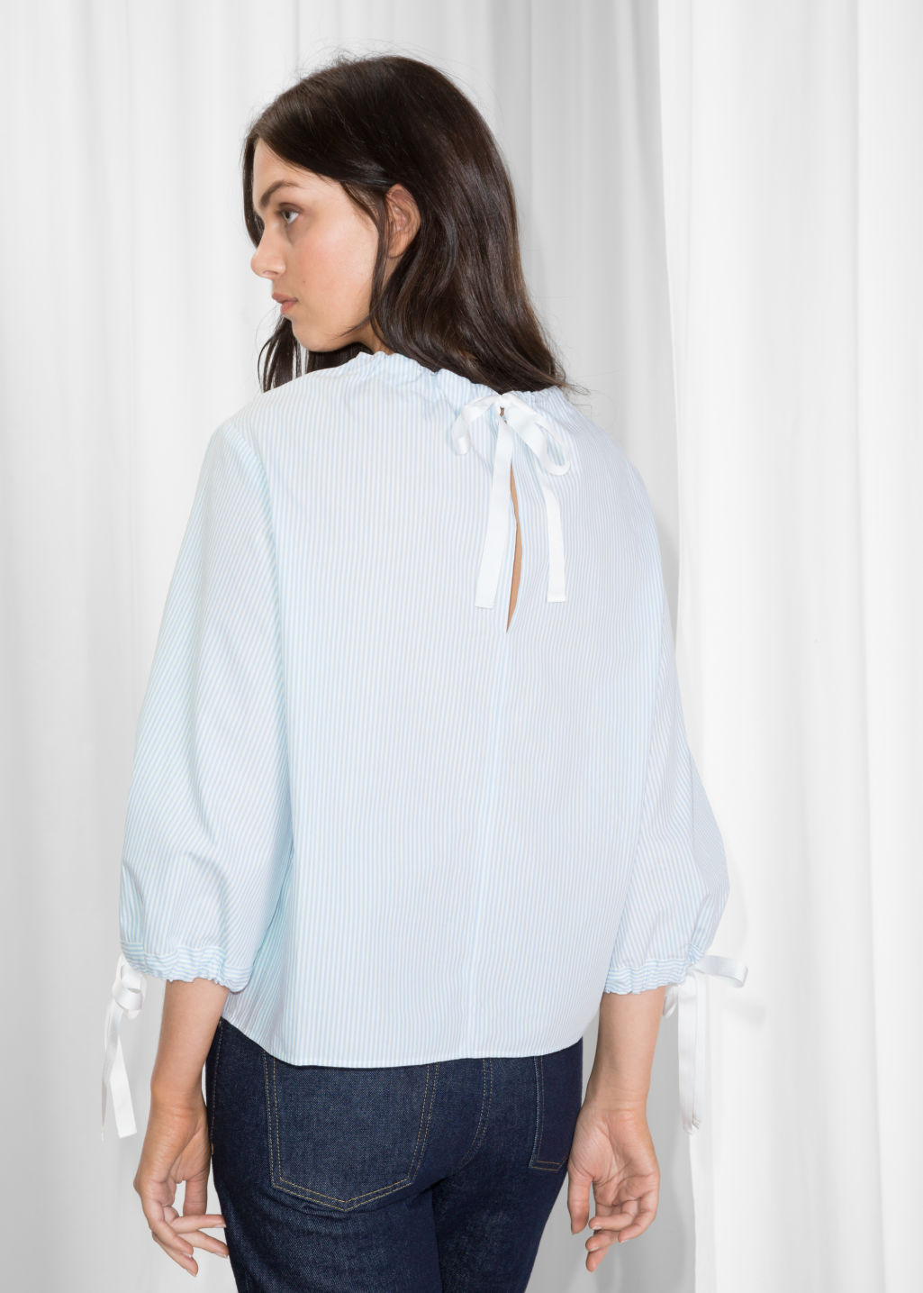 Model back image of Stories tie sleeve cotton blouse in turquoise