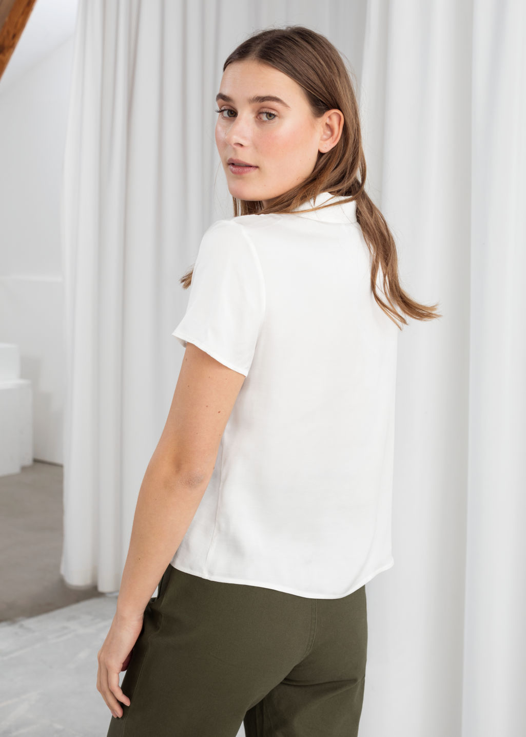 Model back image of Stories relaxed fit satin shirt in white