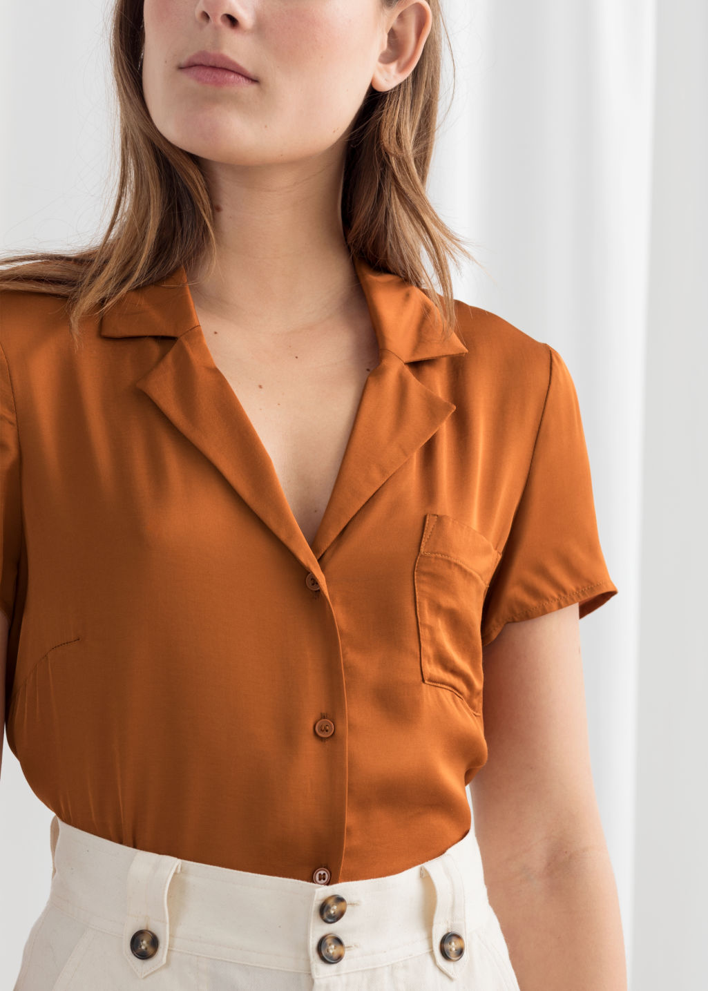 Model back image of Stories relaxed fit satin shirt in orange