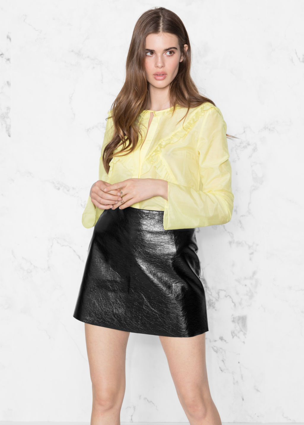 Model front image of Stories flare sleeve frills shirt in yellow