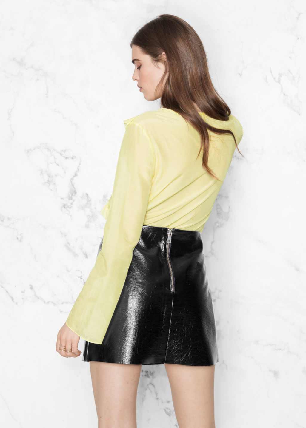 Model back image of Stories flare sleeve frills shirt in yellow