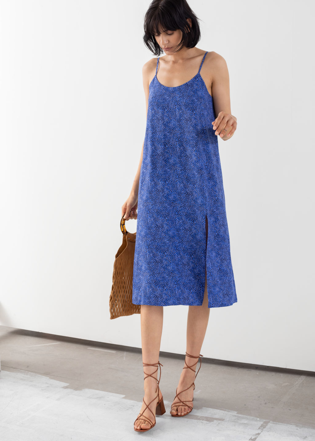 Model front image of Stories v-cut dress in blue