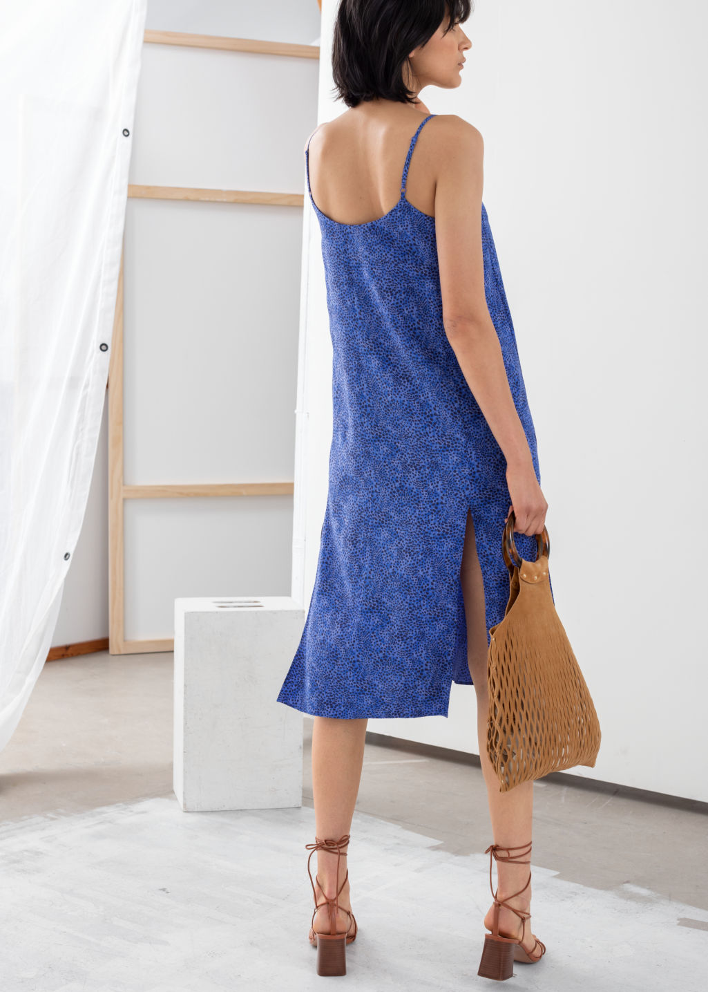Model back image of Stories v-cut dress in blue